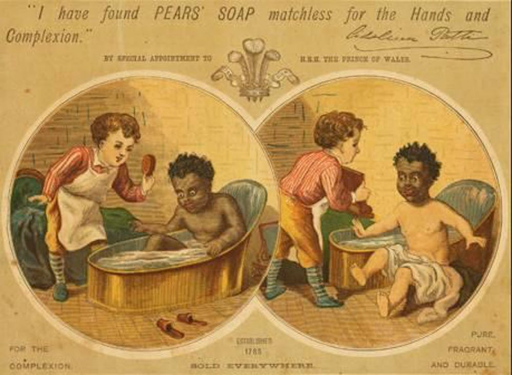 Pearline soap ad depicting soap cleaning brown skin white